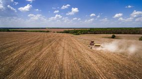 Tractor preparing land for sowing sixteen rows aerial, concept of cultivation, sowing, plowing field, tractor and production autom. Ation, place for text royalty free stock images