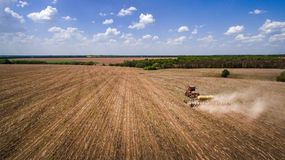 Tractor preparing land for sowing sixteen rows aerial, concept of cultivation, sowing, plowing field, tractor and production autom. Ation, place for text stock photography