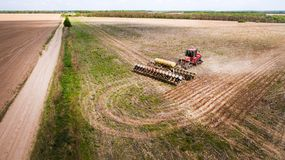 Tractor preparing land for sowing sixteen rows aerial, concept of cultivation, sowing, plowing field, tractor and production autom stock image
