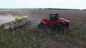 Tractor preparing land for sowing sixteen rows aerial, concept of cultivation, sowing, plowing field, tractor and production autom stock video footage