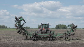 Tractor preparing a seed system in the field stock footage