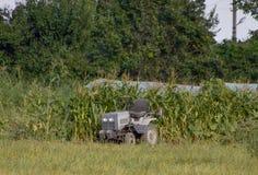 Tractor on a private farm Stock Photo