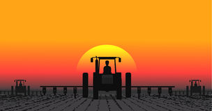 Tractor processes the earth a rural landscape Stock Photo