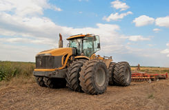 Tractor processes field Stock Images
