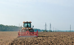 Tractor processes field Stock Photography