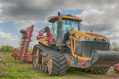 Tractor processes field Royalty Free Stock Photo