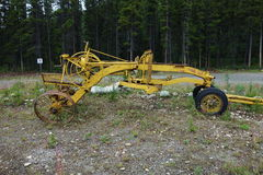 An tractor-pulled grader from the past. Stock Images