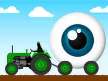 Tractor pulling the eye of giant Stock Image