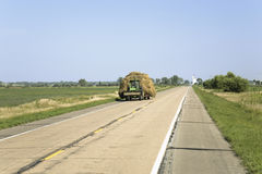 Tractor pulling hay down royalty free stock photo