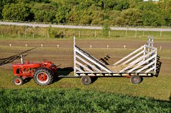 Tractor pulling hay rack Stock Photos