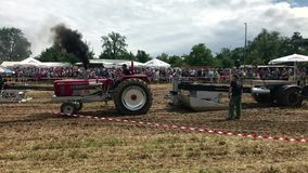 Tractor pulling heavy weight stock footage
