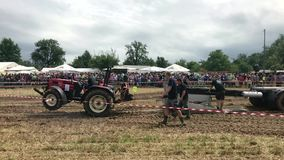 Tractor pulling heavy weight stock video