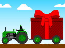 Tractor pulling a huge parcel Royalty Free Stock Photo
