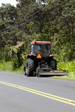 Tractor Pulling Lawn Mower Attachment Road Side Stock Photo
