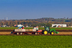 Tractor pulling a wagon with crates Stock Photo