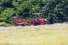 Tractor Pulling a Wheel Rake Royalty Free Stock Images