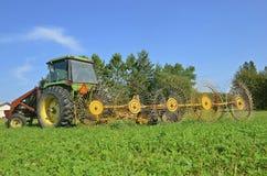 Tractor pulling wheel rake Royalty Free Stock Photos