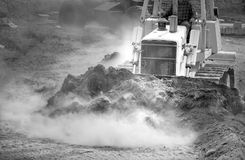Tractor pushing Dirt. A piece of construction equipment working on a building site Stock Image