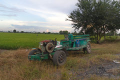 Tractor put on rice field. Background Royalty Free Stock Photography