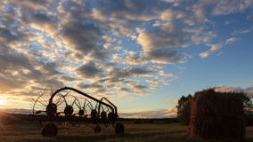 Tractor rake at sunset. Time Lapse stock footage