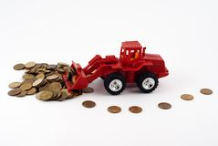 Tractor rakes coins Royalty Free Stock Photos