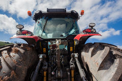 Tractor Rear Agriculture. Rear close photo of detail of new tractor agriculture machine  in red  color parked on road side Royalty Free Stock Image