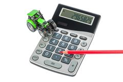 Tractor, red pencil and calculator Royalty Free Stock Photography