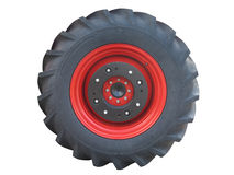 Tractor red tire wheel isolated over white Royalty Free Stock Photography