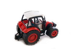 Tractor red toy. Isolated on white Stock Image