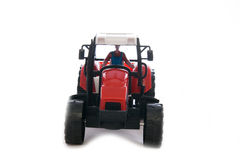 Tractor red toy on white. Background Royalty Free Stock Photo