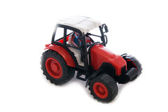Tractor red toy on white. Background Royalty Free Stock Image
