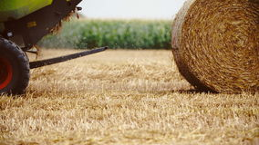 Tractor releases a hay bale, straw. Agriculture background. stock video