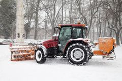 The tractor removal snow in park Royalty Free Stock Photo