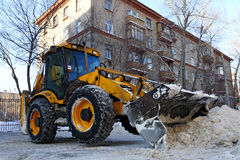 Tractor removes snow Stock Images