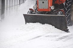 Tractor removes snow Royalty Free Stock Image
