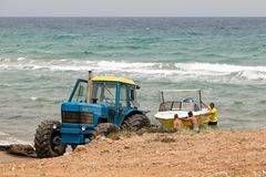 Tractor retrieving a boat from the water royalty free stock photo