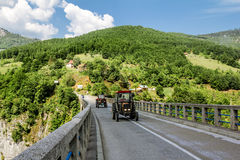The tractor ride on the bridge of Dzhurdzhevich over the river T. Tara River Canyon.Montenegro.04 June, 2015. The tractor ride on the bridge of Dzhurdzhevich Stock Images