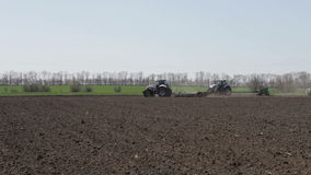 Tractor rides in spring stock footage