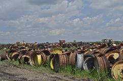 Tractor rim collection. A tractor salvage junkyard is full of old tractor and machinery rims Stock Images