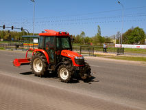Tractor on the road. Royalty Free Stock Image