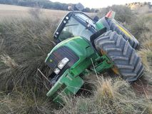 Tractor rolled over in the harvest Stock Image