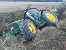 Tractor rolled over in the harvest Royalty Free Stock Photo