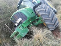 Tractor rolled over in the harvest Royalty Free Stock Photography