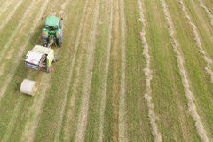 Tractor with round baler - shot from above Royalty Free Stock Photos