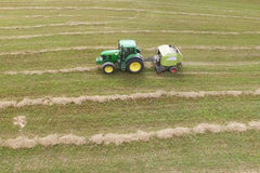 Tractor with round baler - shot from above Stock Photo