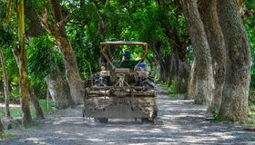 A tractor running on rural road Stock Image