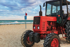 Tractor on the sandy beach Stock Photography