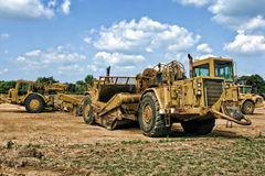 Tractor Scraper Machine On Construction Site Royalty Free Stock Photos
