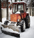 Tractor with scraper in winter day Stock Photography