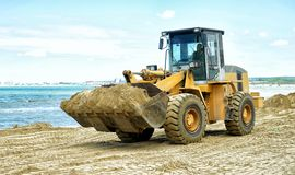 Tractor on the sea beach Royalty Free Stock Photos